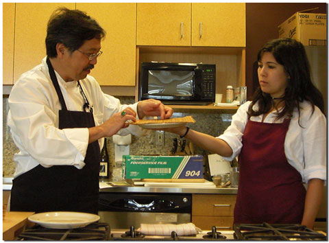 Robert Fong and daughter demonstrate Futomaki sushi rolling